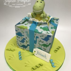 Dinosaur present cake
